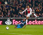 Nederland, Amsterdam, 1 december 2012.Seizoen 2012-2013.Eredivisie.Ajax-PSV .Danny Hoesen (r.) van Ajax schiet. Links Marcelo Antonio Guedes Filho van PSV.