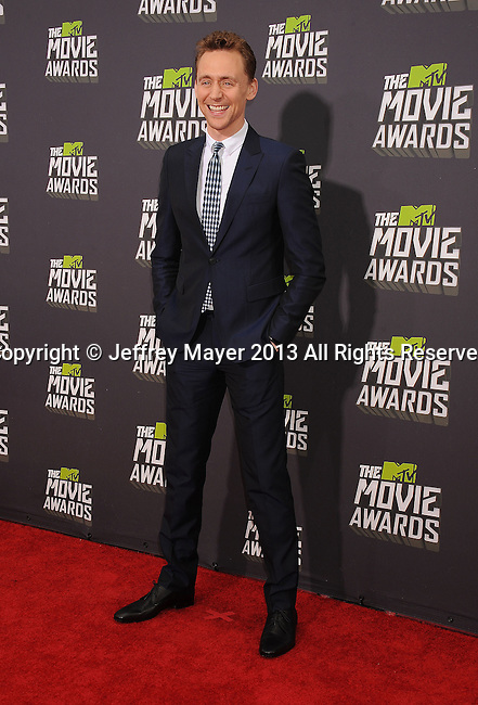 CULVER CITY, CA- APRIL 14: Tom Hiddleston arrives at the 2013 MTV Movie Awards at Sony Pictures Studios on April 14, 2013 in Culver City, California.