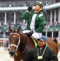 LOUISVILLE, KY - MAY 05: Javier Castellano, aboard Green Mask #12, points to the sky after winning the Twin Spires Turf Sprint on Kentucky Oaks Day at Churchill Downs on May 5, 2017 in Louisville, Kentucky. (Photo by Jessica Morgan/Eclipse Sportswire/Getty Images)