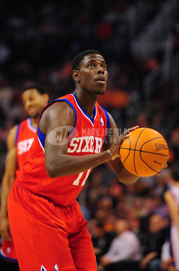 Dec. 28, 2011; Phoenix, AZ, USA; Philadelphia 76ers guard Jrue Holiday takes a foul shot against the Phoenix Suns at the US Airways Center. The 76ers defeated the Suns 103-83. Mandatory Credit: Mark J. Rebilas-USA TODAY Sports