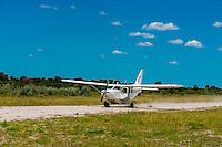 Aircraft landing at airstrip at Nxai Pan Camp, Nxai Pan National Park, Botswana.