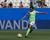 GRENOBLE, FRANCE - JUNE 12: Onome Ebi #5 of the Nigerian National Team passes the ball during a game between Korea Republic and Nigeria at Stade des Alpes on June 12, 2019 in Grenoble, France.
