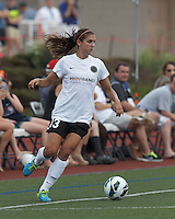 Portland Thorns FC forward Alex Morgan (13) looks to pass. In a National Women's Soccer League (NWSL) match, Portland Thorns FC (white/black) defeated Boston Breakers (blue), 2-1, at Dilboy Stadium on July 21, 2013.
