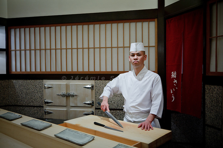 Tokyo, December 9 2010 - At Sushi Saito restaurant, a 3 stars Michelin restaurant in the Akasaka district. Portrait of the chef, Takashi Saito, in his restaurant. In 2010, Tokyo is still the leading city in the world for the number of 3stars restaurants.
