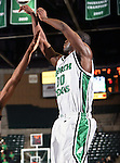 North Texas Mean Green forward Jacob Holmen (30) goes up for a jump shot in the game between the Texas State Bobcats and the University of North Texas Mean Green at the North Texas Coliseum,the Super Pit, in Denton, Texas. UNT defeated Texas State 85 to 62