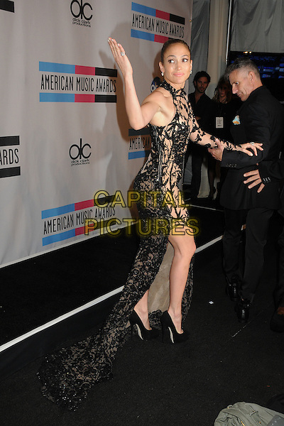Jennifer Lopez.2011 American Music Awards - Press Room held at Nokia Theatre LA Live, Los Angeles, California, USA..November 20th, 2011.ama amas ama's full length black dress sheer lace one sleeve train sleeveless slit split side hand arm looking over shoulder.CAP/ADM/BP.©Byron Purvis/AdMedia/Capital Pictures.