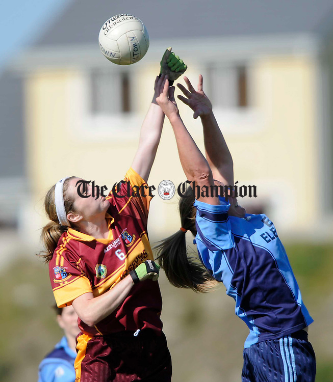 Miltown's Siobhan Lafferty contests the ball with Cooraclare's Eithne Morrissey during their Ladies Senior championship B final at Kilmihil. Photograph by John Kelly.