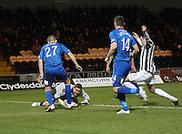 Daniel Devine helps out Antonio Reguero in the St Mirren v Inverness Caledonian Thistle Clydesdale Bank Scottish Premier League match played at St Mirren Park, Paisley on 30.1.13.