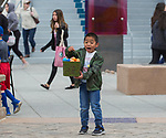 An excited young boy shows off his haul during the Easter Egg Hunt at Legends in Sparks, Nevada on Saturday, April 20, 2019.