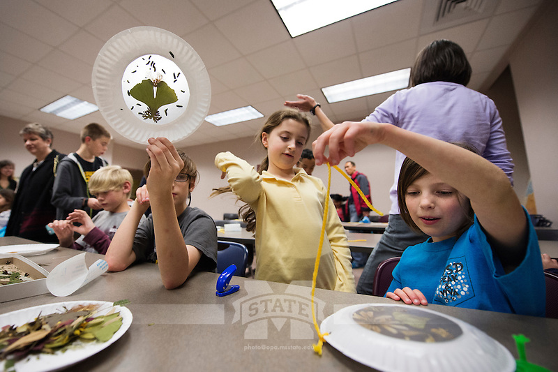 Science Night at the Museum (Darwin Week): children engage with botanical art projects.<br />  (photo by Megan Bean / &copy; Mississippi State University)