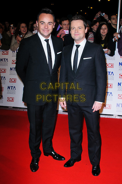 Anthony McPartlin and Declan Donnelly.arrivals at The National Television Awards, O2 Greenwich, London, England. 25th January 2012.NTA NTAS full length black suit ant dec.CAP/CJ.©Chris Joseph/Capital Pictures.