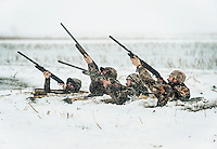 From left, OutdoorLife Editor Andrew McKean (cq), Pat Berggren (cq), Web Editor for Ducks Unlimited Chris Jennings (cq), and PR and Web Director for the National Wild Turkey Federation Brent Lawrence (cq) take a shot for duck during a hunt just off the duck-rich Platte River in Nebraska, Saturday, December 3, 2011...Photo by Matt Nager