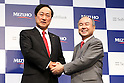 Mizuho Financial Group president and CEO Yasuhiro Sato, left, and SoftBank group Chairman and CEO Masayoshi Son attend a press conference in Tokyo, Japan on September 15, 2016. SoftBank and Mizuho Financial Group announced the launch a joint venture for a new personal loan service using FinTech technology. (Photo by AFLO)