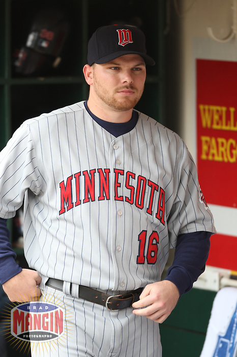 OAKLAND, CA - June 1:  Jason Kubel of the Minnesota Twins relaxes in the dugout before the game against the Oakland Athletics at the McAfee Coliseum in Oakland, California on June 1, 2007.  The Athletics defeated the Twins 1-0.  Photo by Brad Mangin