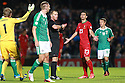 SERIES OF IMAGES  Northern Ireland's Gareth McAuley looks on as Portugal's  Helder Postiga gets a red card for head butting McAuley and being sent off during the first half a World Cup Qualifier in Belfast, Friday September 6th, 2013.  Photo/Paul McErlane