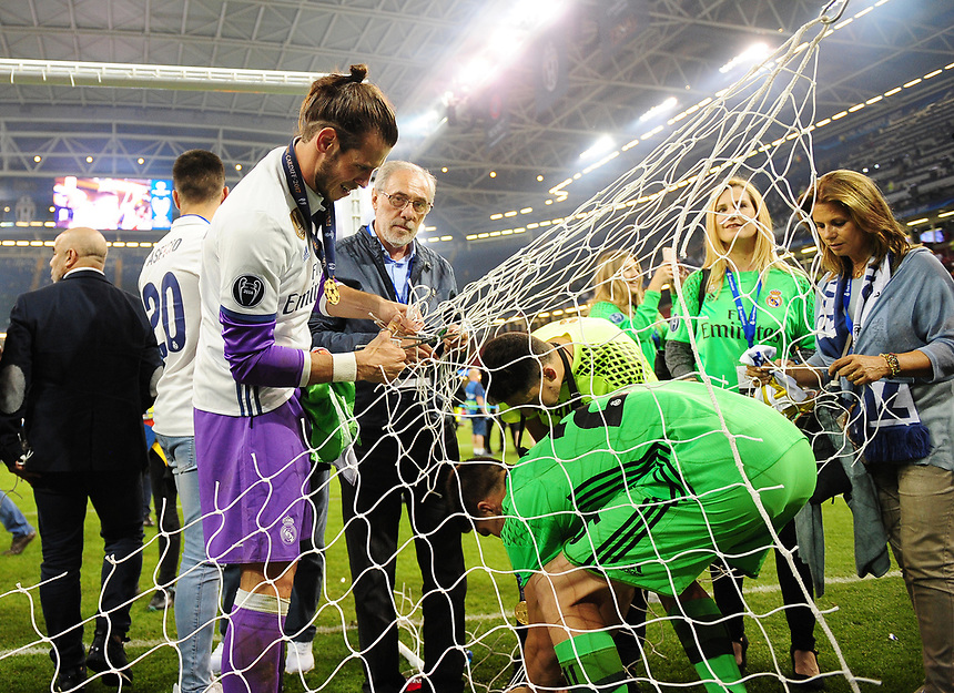 Gareth Bale of Real Madrid cuts down a section of the goal netting<br /> <br /> Photographer Kevin Barnes/CameraSport<br /> <br /> UEFA Champions League Final - Juventus v Real Madrid - Saturday 3rd June 2017 - Principality Stadium - Cardiff<br />  <br /> World Copyright &copy; 2017 CameraSport. All rights reserved. 43 Linden Ave. Countesthorpe. Leicester. England. LE8 5PG - Tel: +44 (0) 116 277 4147 - admin@camerasport.com - www.camerasport.com
