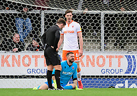 Referee Anthony Backhouse checks on the condition of Blackpool's Mark Howard after he suffered an injury<br /> <br /> Photographer Chris Vaughan/CameraSport<br /> <br /> The EFL Sky Bet League One - Burton Albion v Blackpool - Saturday 16th March 2019 - Pirelli Stadium - Burton upon Trent<br /> <br /> World Copyright &copy; 2019 CameraSport. All rights reserved. 43 Linden Ave. Countesthorpe. Leicester. England. LE8 5PG - Tel: +44 (0) 116 277 4147 - admin@camerasport.com - www.camerasport.com