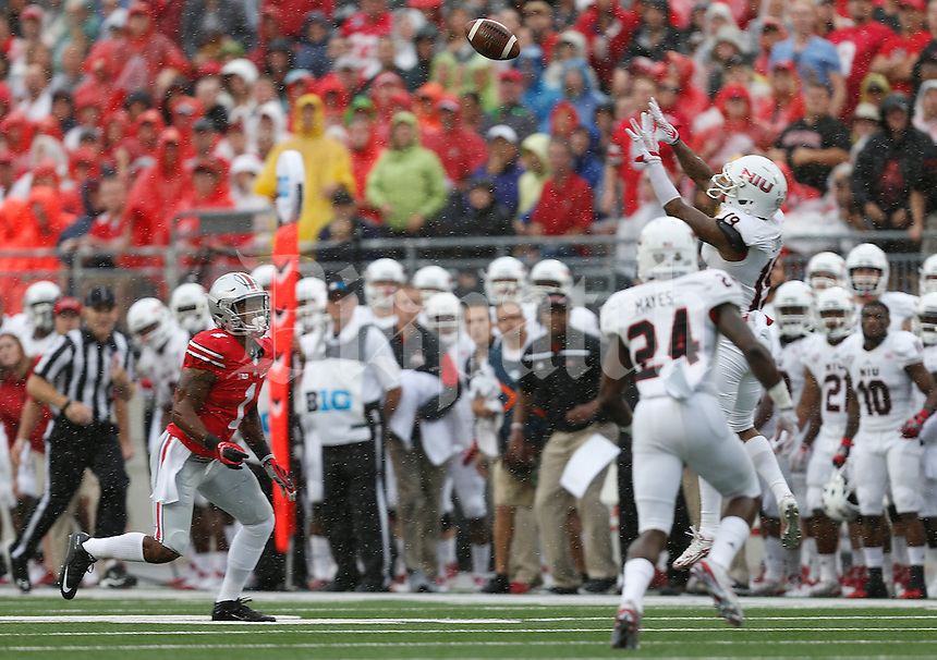 Northern Illinois Huskies cornerback Shawun Lurry (19) intercepts a pass meant for Ohio State Buckeyes wide receiver Braxton Miller (1) in the first quarter of the college football game between the Ohio State Buckeyes and the Northern Illinois Huskies at Ohio Stadium in Columbus, Saturday afternoon, September 19, 2015. As of half time the Ohio State Buckeyes were tied with the Northern Illinois Huskies 10 - 10. (The Columbus Dispatch / Eamon Queeney)