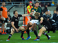 Handre Pollard beats Ben Smith and Jack Goodhue during the Rugby Championship rugby union match between the New Zealand All Blacks and South Africa Springboks at Westpac Stadium in Wellington, New Zealand on Saturday, 27 July 2019. Photo: Dave Lintott / lintottphoto.co.nz
