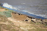 Erosion on top of sea wall as a result of scouring by wave backwash undermining coastal defences, East Lane, Bawdsey, Suffolk, England