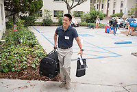 Associate professor of psychology Brian Kim helps incoming first years move into Stewie. Incoming first-years and their families are welcomed by O-Team members and the community at the start of Occidental College's Fall Orientation for the class of 2021, Aug. 24, 2017.<br /> (Photo by Marc Campos, Occidental College Photographer)