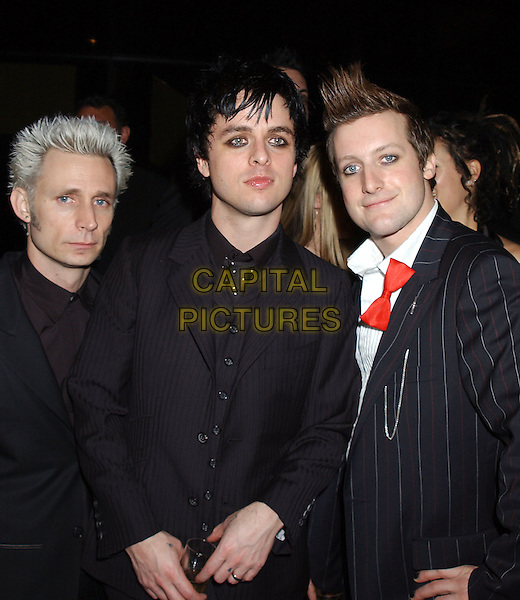 MIKE DIRNT, BILLIE JOE ARMSTRONG & TRE COOL - GREEN DAY.2005 Warner Music Group Post Grammy Party held at the Pacific Design Centre. .February 13th, 2005.Photo Credit: J.J. SansoneAdMedia.half length bow tie pinstripe eye make-up eyeliner.www.capitalpictures.com.sales@capitalpictures.com.© Capital Pictures.