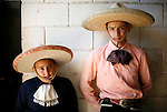 Left to right, JB, 10, and Alex Gomez, 15, are the fourth generation of Charros in their family, originally from Mexico. Charreada, a Mexican rodeo, is a 400 year old Mexican tradition that combines ranch work sports with stylish outfits and traditions of generations of families. (Benjamin Sklar for ESPN the Magazine)