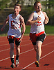 With the 3,200 meter race having long since been decided, Connetquot senior Brian Kissmer, right, finds himself all alone in first place as junior Tim Monahan defers to the upperclassman by jokingly pulling up lame down the final stretch in a Suffolk County boys' track and field meet against Middle Country at Connetquot High School on Thursday, May 14, 2015.<br /> <br /> James Escher