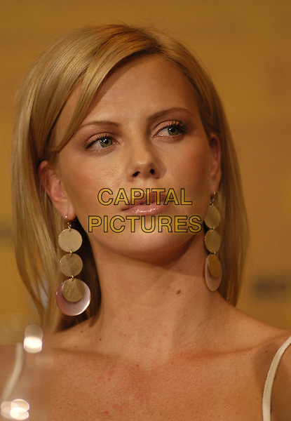 "CHARLIZE THERON.""Monster"" press conference.Berlin Film Festival, Germany.08 February 2004.portrait headshot, big drop dangly earrings.sales@capitalpictures.com.www.capitalpictures.com.©Capital Pictures"