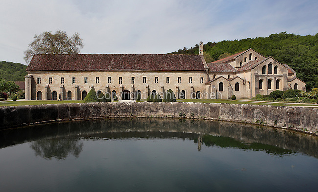 Fontenay Abbey, Marmagne, Cote d'Or, France. This Cistercian abbey was founded by Saint Bernard of Clairvaux in 1119, built in the Romanesque style. The abbey itself housed 300 monks from 1200, but was sacked during the French Revolution. The southern transept arm is extended by a vast quadrangular area housing the Monks' Room which links the religious and domestic buildings. It is backed by formal gardens leading to the monks' medicinal and herb garden. The church can be seen on the right. Picture by Manuel Cohen