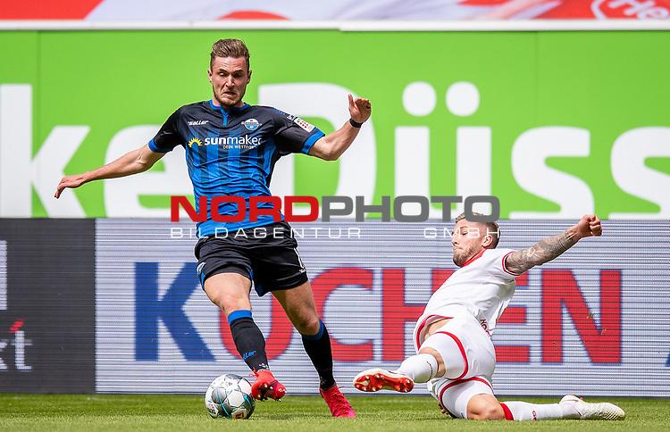 nph00351: Fussball, 1. Bundesliga, Saison 19/20, 26. Spieltag, Fortuna Düsseldorf - FC Paderborn 07, 16.05.2020:<br /> Dennis Srbeny (SCP), Andre Hoffmann (F95)<br /> <br /> Nur für journalistische Zwecke! Only for editorial use!<br /> <br /> Gemäß den Vorgaben der DFL Deutsche Fußball Liga ist es untersagt, in dem Stadion und/oder vom Spiel angefertigte Fotoaufnahmen in Form von Sequenzbildern und/oder videoähnlichen Fotostrecken zu verwerten bzw. verwerten zu lassen. DFL regulations prohibit any use of photographs as image sequences and/or quasi-video. <br /> <br /> Foto: Moritz Müller/Pool / via Meuter/nordphoto