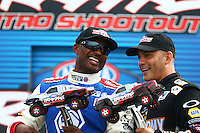 Aug 30, 2014; Clermont, IN, USA; NHRA top fuel dragster driver Antron Brown (left) and Tony Schumacher at driver introductions for the Traxxas Shootout during qualifying for the US Nationals at Lucas Oil Raceway. Mandatory Credit: Mark J. Rebilas-USA TODAY Sports