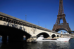 A tour boat under Pont d'Iéna Iena bridge with Eiffel Tower La tour eiffel in the background. City of Paris. Paris. France