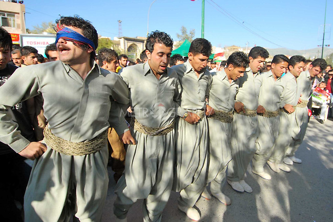 SULAIMANIYAH, IRAQ: Kurdish men do a traditional dance during Newroz celebrations...Newroz, celebrated across the world on the vernal equinox, is the official beginning of the Kurdish calendar and the first day of spring.  Kurds celebrate Newroz on March 20th and 21st by lighting fires and performing traditional dances...Photo by Ranj Abdullah/ Metrography