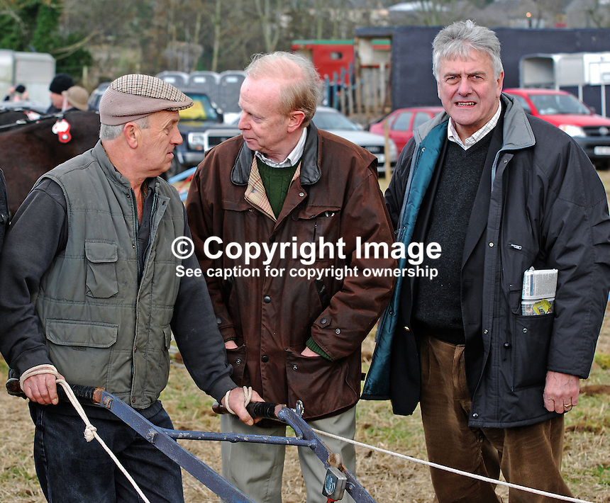 Politicians took advantage of the event to raise their profile.  Unionist &amp; Conservative Party Leader, Sir Reg Empey (centre), and Jim Nicholson,, who defends his seat in the forthcoming Euro Elections(right), bend the ear of Cookstown, Co Tyrone, competitor. Taken 28 February 2009 at 95th annual ploughing match of Mullahead &amp; District Ploughing Society, Co Down, N Ireland, UK, 200902281913.<br />