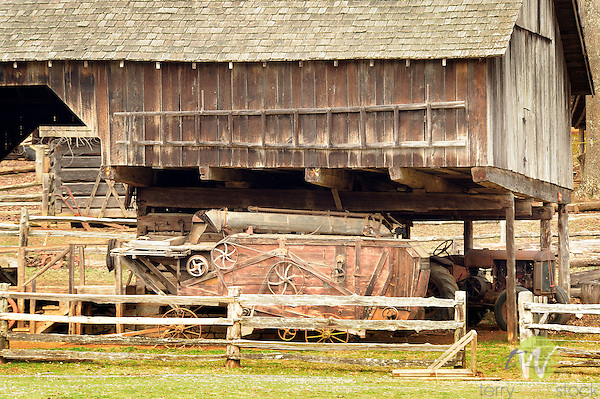 Museum of Appalachia, Clinton, TN. Old combine and tractor at barn.