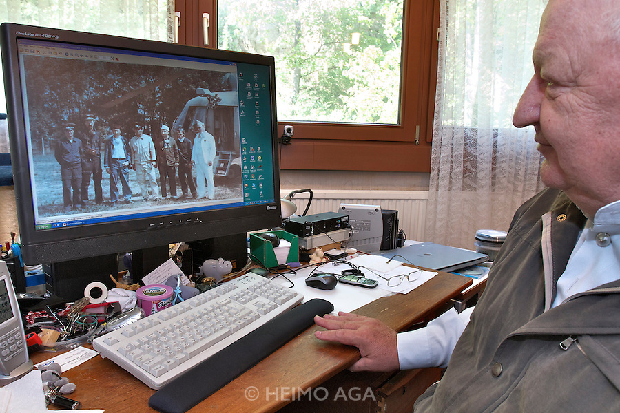 Vienna. Iouli Andreev, former Chief Liquidator during the Chernobyl nuclear catastrophe. Lives in Vienna with his wife, cat and one remaining lung. Here he shows a picture of himself in 1986 after flying in a helicopter over the reactor accident (3rd from r.).