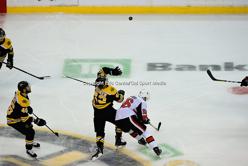 April 7, 2018: Boston Bruins center Danton Heinen (43) and Ottawa Senators left wing Magnus Paajarvi (56) battle for the flying puck during the NHL game between the Ottawa Senators  and the Boston Bruins held at TD Garden, in Boston, Mass. Boston defeats Ottawa 5-2 Eric Canha/CSM