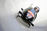 15 December 2007: Great Britain 1 pilot Lee Johnston with brakeman Matthew Roberts exit a turn during their first run at the FIBT World Cup Bobsled Competition at the Olympic Sports Complex on Mount Van Hoevenberg, at Lake Placid, New York, USA. ..Mandatory Photo Credit: Ed Wolfstein Photo
