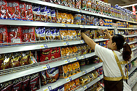 Cadbury and Dove chocolates are on sale in a Carrefour supermarket in Beijing, China. Major international chains like Carrefour and Walmart Stores have expanded aggressively in China. Local Chinese retailers have loudly protested this and lobbied heavily for protection from the new competition in price and service that these major retailers have set off..22 Jul 2006