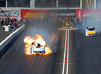 Feb 24, 2018; Chandler, AZ, USA; NHRA funny car driver Tommy Johnson Jr explodes an engine on fire during qualifying for the Arizona Nationals at Wild Horse Pass Motorsports Park. Johnson would be uninjured in the incident. Mandatory Credit: Mark J. Rebilas-USA TODAY Sports