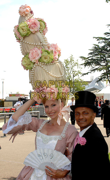 Anneka Svenska & Louis Mariette.Day 1 of Royal Ascot at Ascot Racecourse, Ascot, England..June 14th, 2011.half length costume white fan hat tall hair roses flowers pink beige dress flowers black suit jacket top hat.CAP/WIZ.© Wizard/Capital Pictures.