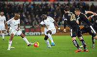 (L-R) Andre Ayew and Bafetimbi Gomis of Swansea during the Barclays Premier League match between Swansea City and Leicester City at the Liberty Stadium, Swansea on December 05 2015