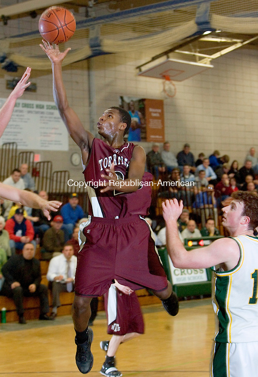 WATERBURY, CT- 13 JANUARY 2009 --011309JS10-Torrington's Martin Mitchell (25) puts up a shot during their game against Holy Cross Tuesday at Holy Cross High School in Waterbury. <br /> Jim Shannon / Republican-American