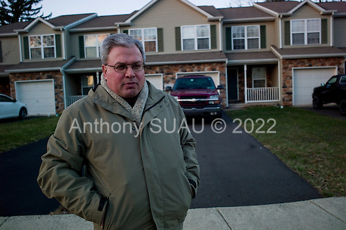 Selllersville, Pennsylvania<br /> March 24, 2011<br /> <br /> 51 year old Steve Nathan, a 99er, paralegal, stands outside his home of 11 years, 5 months after he was evicted. He lost his benefits in late 2010 and now lives in one room of a friend's home out of a suitcase. His landlords are Darwin Roseberry and Barbara Wise a 70 year old married couple who live on a farm and practice law.