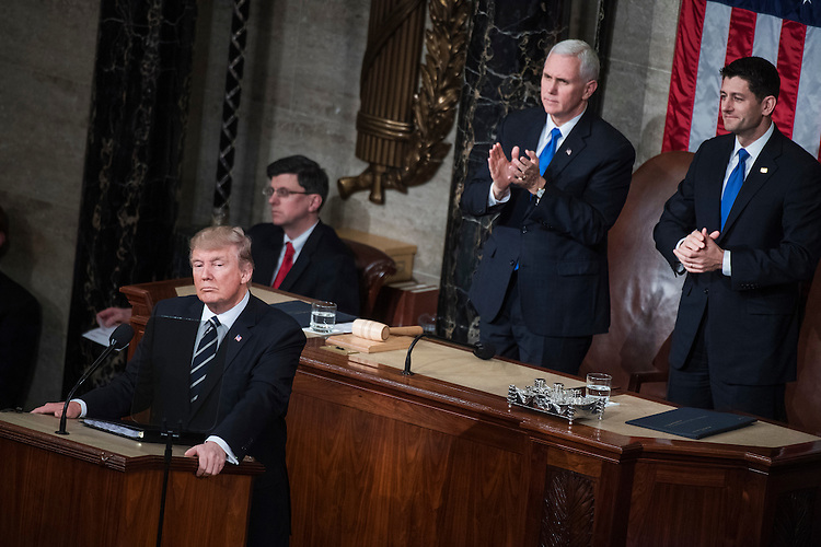 UNITED STATES - FEBRUARY 28: President Donald Trump addresses a joint session of Congress in the Capitol's House Chamber, as Speaker Paul Ryan, R-Wis., right, and Vice President Mike Pence, look on, February 28, 2017. (Photo By Tom Williams/CQ Roll Call)