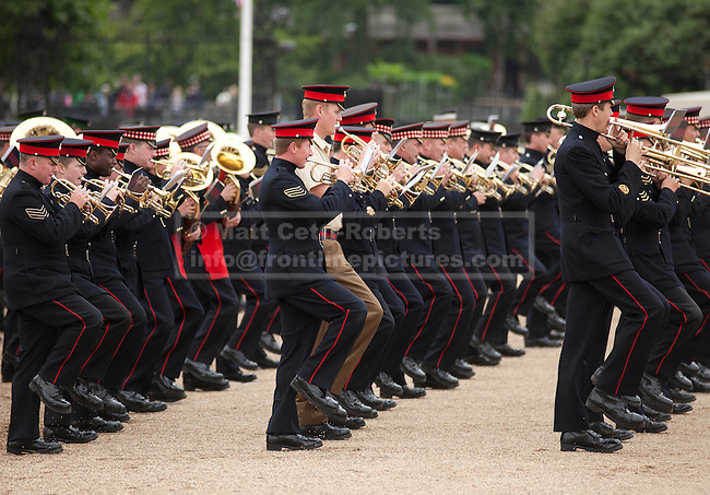 LONDON, UK.  06/06/11. British Army bands personnel march towards the lens as they rehearse ahead of this week's beating the retreat parade. The United States Army Band join with the Massed Bands and Corps of Drums of the Household Division to rehearse Beat Retreat at Horse Guards Parade. The event takes place on 8th and 9th June for featuring the US band the first time. The US visit comes two weeks after the State visit to London of the US President.