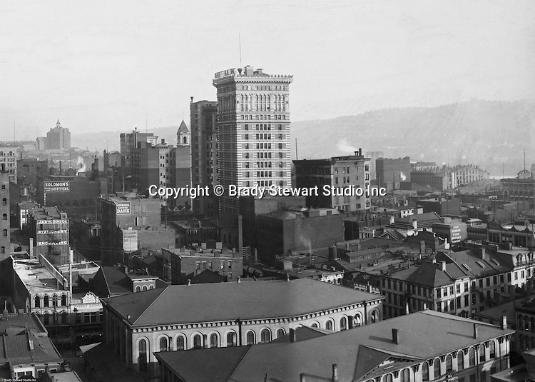 Pittsburgh PA: View of City from the top of the Empire Building - 1904. View of the city toward the Monongahela River. Arrott Building dominates the skyline. Company signs on the city buildings include: J.R. Weldin & Company Stationery and Engraving, Solomon's Outfitters, The German Fire Insurance Company, and the Peoples Savings Bank