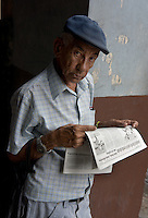 old man reading granma newspaper, Havana, Cuba