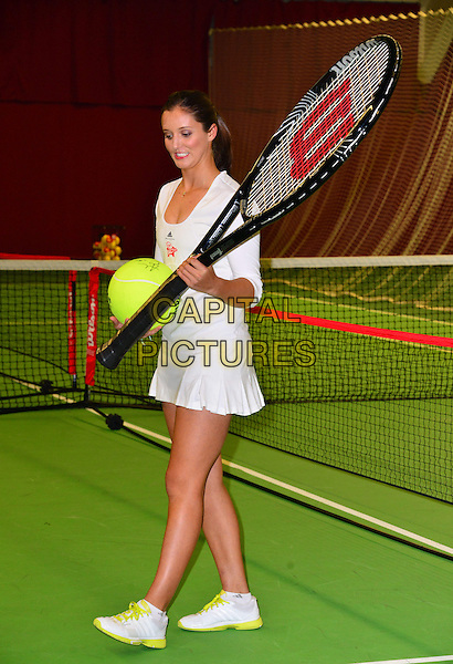 Laura Robson  .Press conference & photocall where British tennis star, Laura Robson, becomes Virgin Active's first tennis ambassador & the face of Virgin Active's Junior Tennis Academy, Virgin Active Chiswick Riverside, London, England..February 26th, 2013.full length giant large oversized racquets white skirt dress court mouth open funny .CAP/BF.©Bob Fidgeon/Capital Pictures.